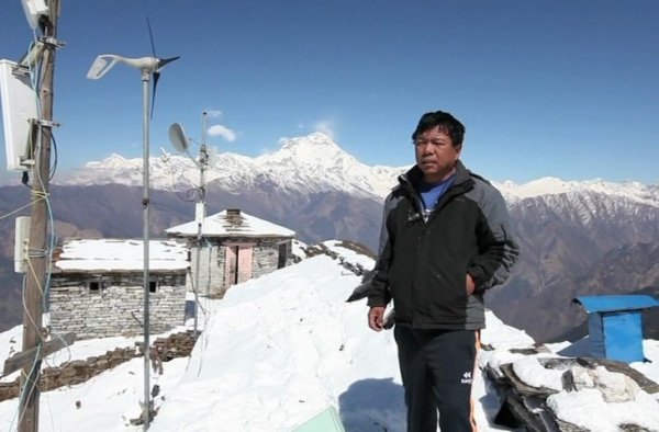 Dr Mahabir Pun at the project site after establishing devices in rural Nepal