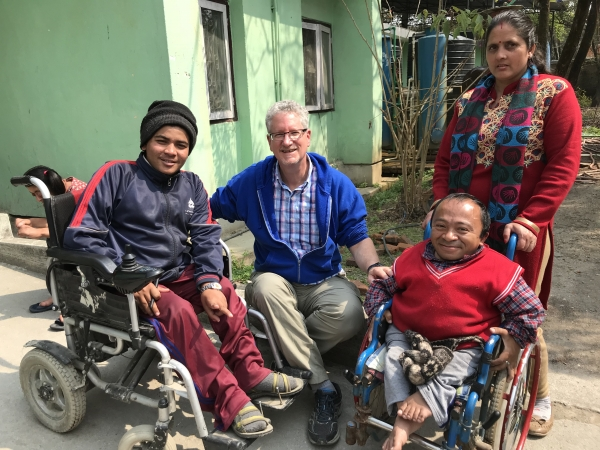 Mr Robert Rose with children with disabilites in Nepal